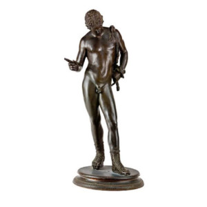 A late 19th century patinated bronze figure of Narcissus, after the Antique
