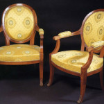 Pair of Restauration walnut fauteuils after
