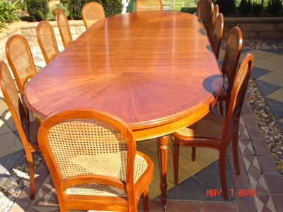 Restored extension dinning table & chairs long view after